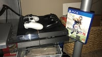 Sony ps4 console with 2 controllers and 1 game