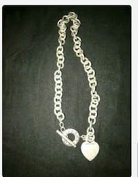 silver-colored necklace with pendant 2277 mi