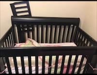 Baby's black wooden crib with bedding set