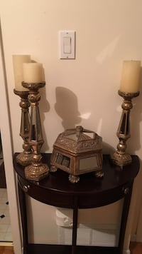 three gold candle holders