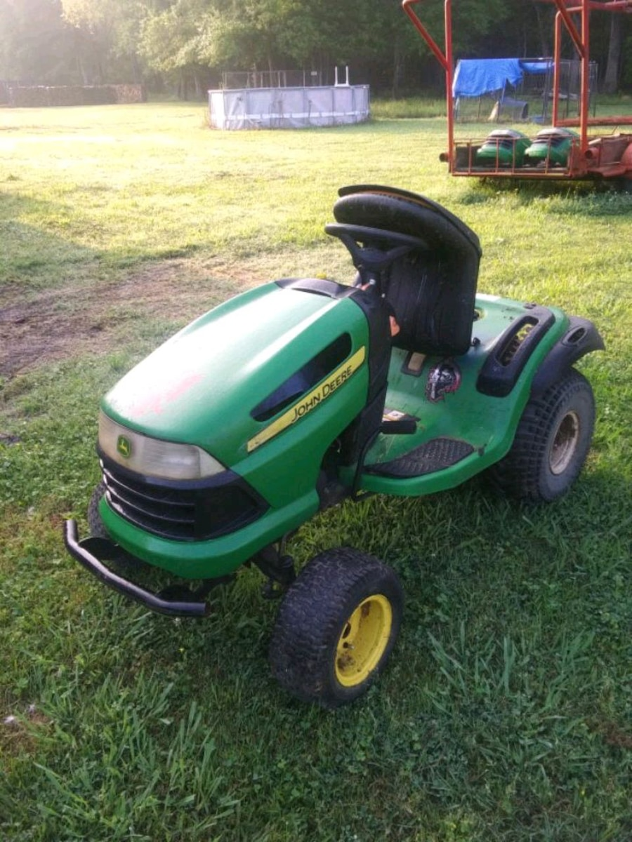 Photo John Deer riding mower and parts for sale