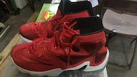Pair of red nike lebron basketball shoes