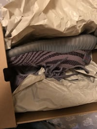 pair of pirate black Adidas Yeezy Boost 350 with box