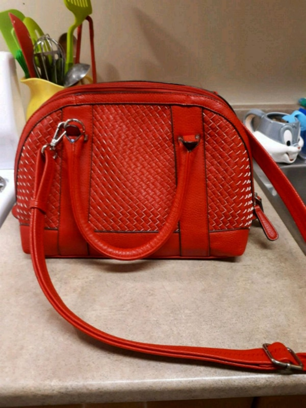 fc4971bee9bc Used NEW RED LEATHER SIDE BAG FOR SALE for sale in Kingston ...