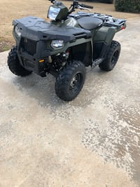 Black and gray atv quad bike Roebuck