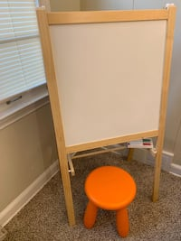 blackboard and whiteboard with chair