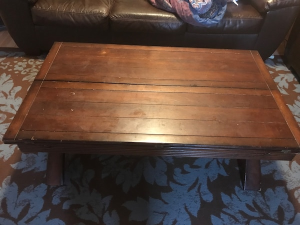 Solid wood coffee table some scratches opens and extends