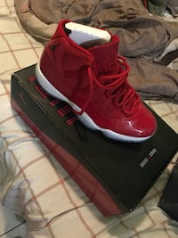 Pair of red jordans shoes with box College Park, 20740