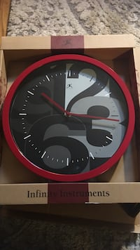 Red and gray analog wall clock 37 km