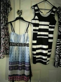 two teal-and-purple and black-and-white sleeve-less mini dresses
