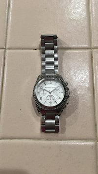 round silver bezel Michael Kors chronograph watch with silver link