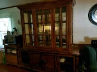 brown wooden framed glass display cabinet East Moline, 61244