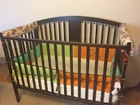 Baby's 4 in 1 brown wooden crib. With under crib storage drawer Vaughan, L4K 5S2
