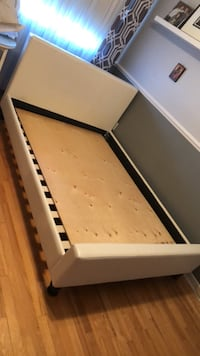 White leather double bed frame- no box spring needed Laval, H7V 1N2