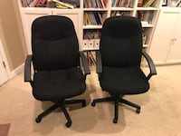 Two (2) black cloth swivel office chairs on wheels. Naperville, 60564