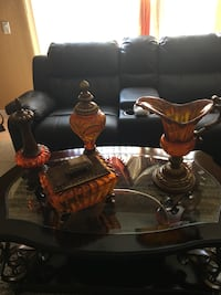 four brown glass vases