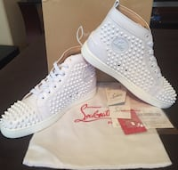 pair of white Red Bottoms shoes with box