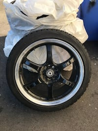 black 5-spoke vehicle wheel and tire Vancouver, V6G 1W2
