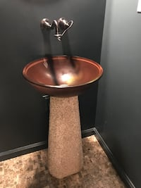 Bathroom pedestal with faucet and sink bowl