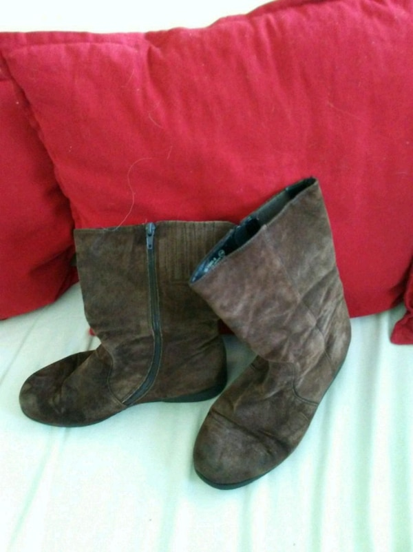pair of brown leather suede boots