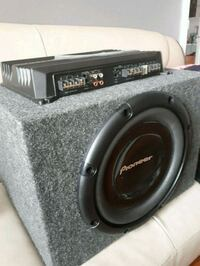 NEW car amplifier and gray Pioneer subwoofer