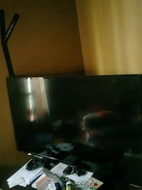 black flat screen TV with remote Compton, 90221
