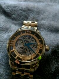 round gold chronograph watch with link bracelet Akron