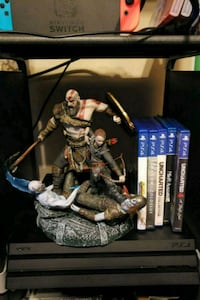 Ps4 pro with games and statue Chattanooga, 37343