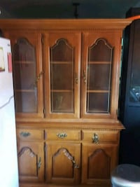 brown wooden framed glass display cabinet Surrey, V3R 7C1