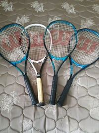 four assorted-color tennis rackets Regina, S4T 2M2