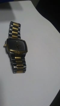 "black and gold Nixon watch ""The Player"" Regina, S4T 2T6"