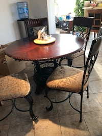 round brown wooden table with four chairs dining set Clinton, 20735