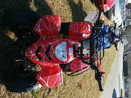 red and black standard 4 wheeler, $689