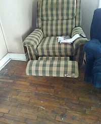 beige and green checked fabric recliner sofa chair