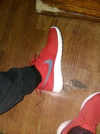 pair of red-and-white Nike running shoes