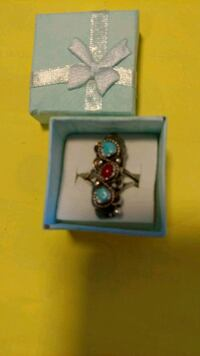 Three genuine turquoise set in stainless steel  St. Louis, 63125