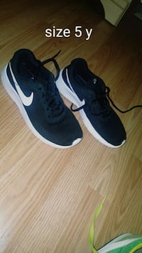 pair of black-and-white Nike running shoes St. Louis, 63123