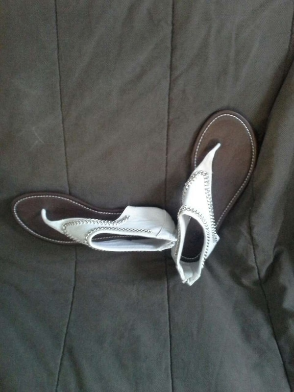 54859aa77 Used pair of women s white and brown slide on slippers for sale in Denton
