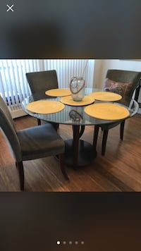 $2000 for $399 today only!! Gorgeous 5 olive toned solid chairs matched with heavy thick 4 feet round glass table top and very modern dark wood base for glass top paid $2000 This is nice no scratches or marks at all sat in my aunts home , while she lived  Edmonton, T6G 1E9