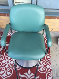 Teal leather padded rolling armchair Mississauga, L4W