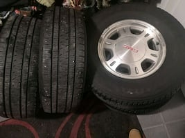 265/70R16 GMC ALLOY RIMS AND TIRES