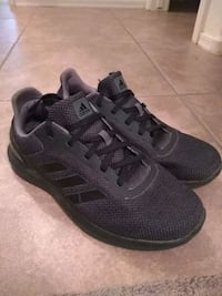 pair of black and gray adidas running shoes 1934 mi