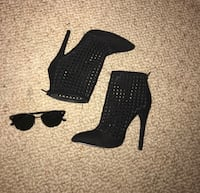 Pair of black suede perforated stiletto ankle booties