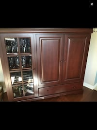 Solid cherry wood TV cabinet with glassed-in display shelving null