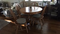 round brown wooden table with four chairs dining set Langley, V1M 1Y4