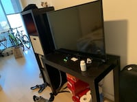 black flat screen TV with black wooden TV stand Washington, 20024
