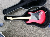 red and black electric guitar in case College Park, 20740
