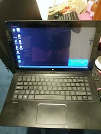 black and gray HP laptop Essex, 21221