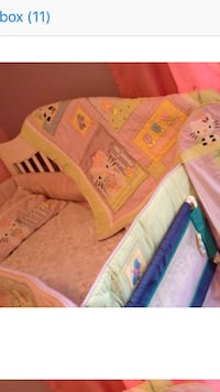 baby's pink and white crib Oakville