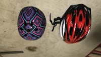 two black and red bicycle helmets Port Saint Lucie, 34952